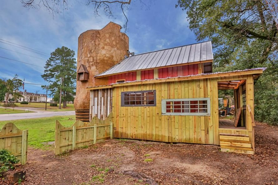 Cowboy Boot House, Phoenix Connection, Dan Phillips, texas boot house, boot home, boot-shaped home texas, texas architecture, real estate texas, custom cabinetry, reclaimed materials, reclaimed wood, undulated metal walls, spiral staircase, boot home in texas, texas tiny homes, quirky home design, green design, sustainable design, wooden homes, eco-friendly home design