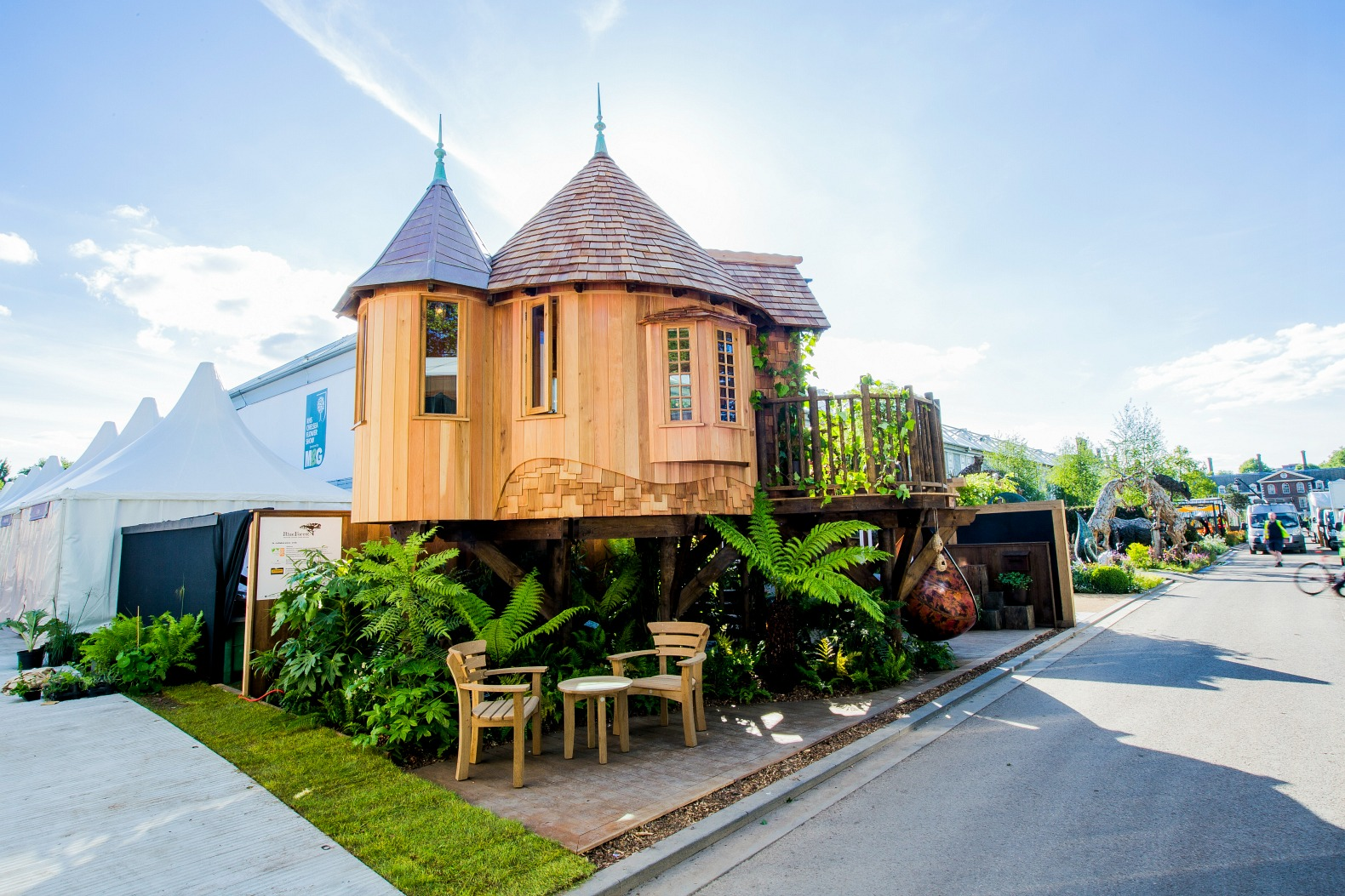 Magical blue forest treehouse is a fairytale castle for for Forest house