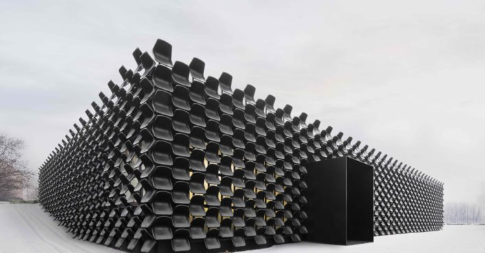 This crazy building's facade is made from 900 black plastic chairs