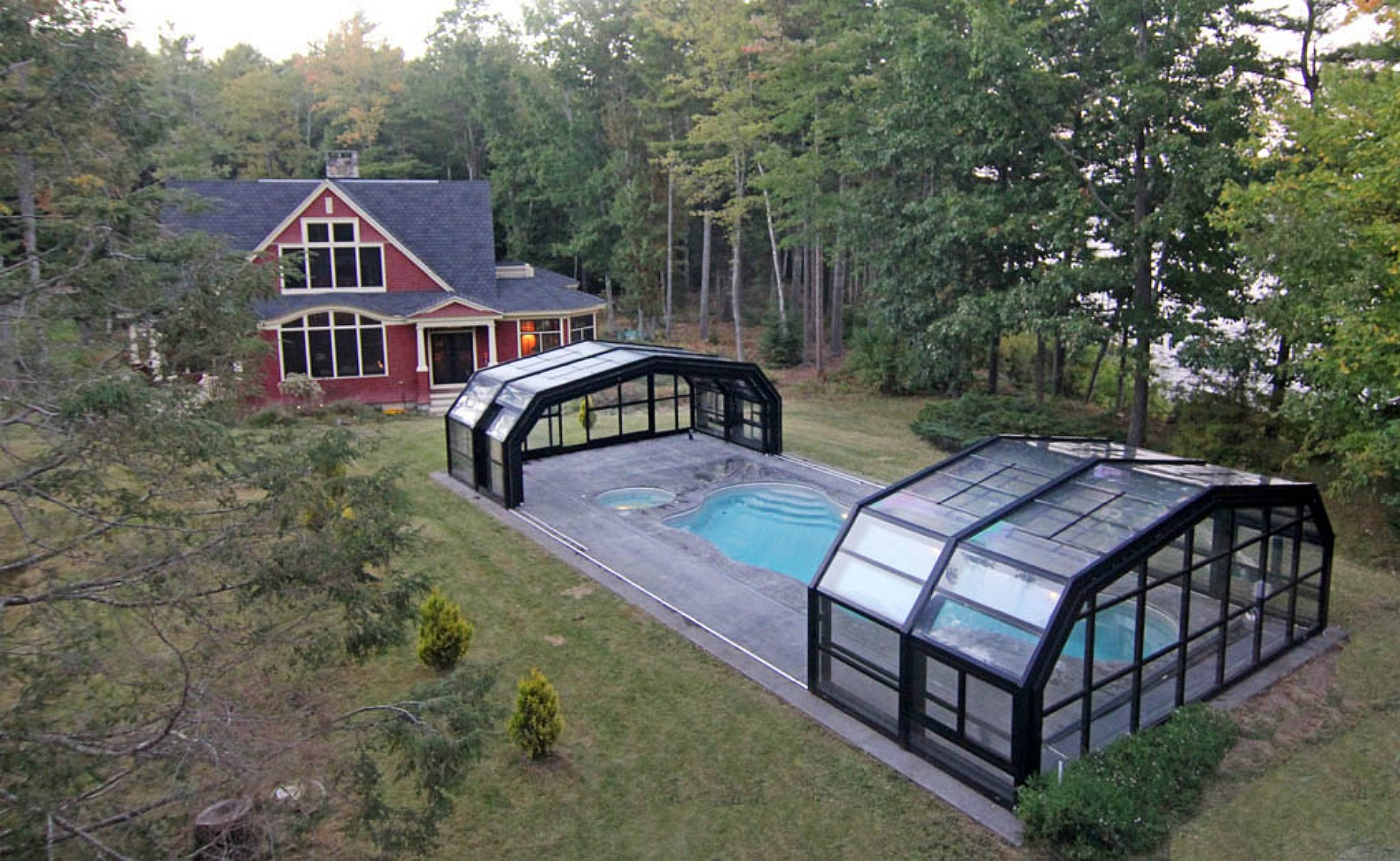 This amazing retractable roof shelters a pool in Maine for year-round fun