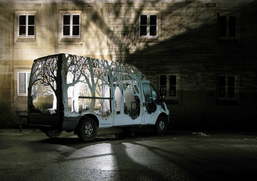 Dan Rawlings, Nature Delivers, art, van art, nature-inspired art, forest art, street sign art, urban art, vehicle art, Lost Eden festival, metal sculpture, art sculpture, metal cutting art, repurposed vans, urban artists, graffiti art,