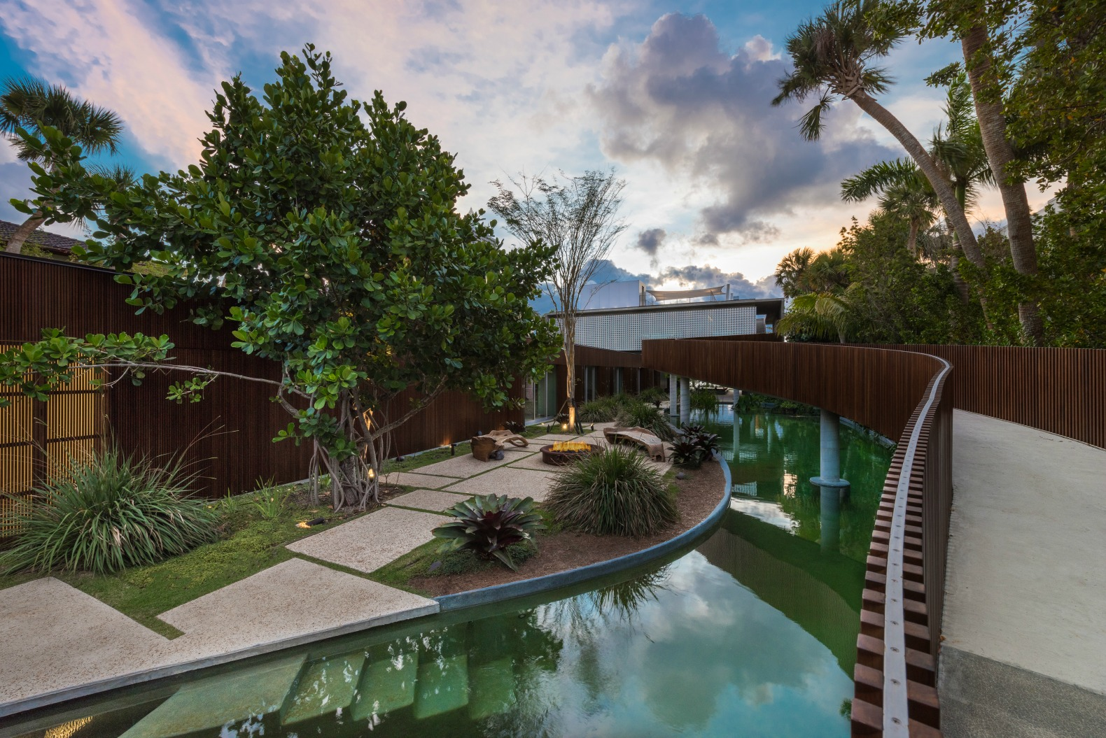 This tropical paradise home has an all natural swimming for Sustainable swimming pools