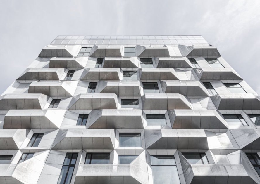 the Silo by COBE, The Silo Nordhavn, The Silo apartments, repurposed silo architecture, galvanized steel facade, adaptive reuse apartments, Nordhavn apartments, adaptive reuse silo