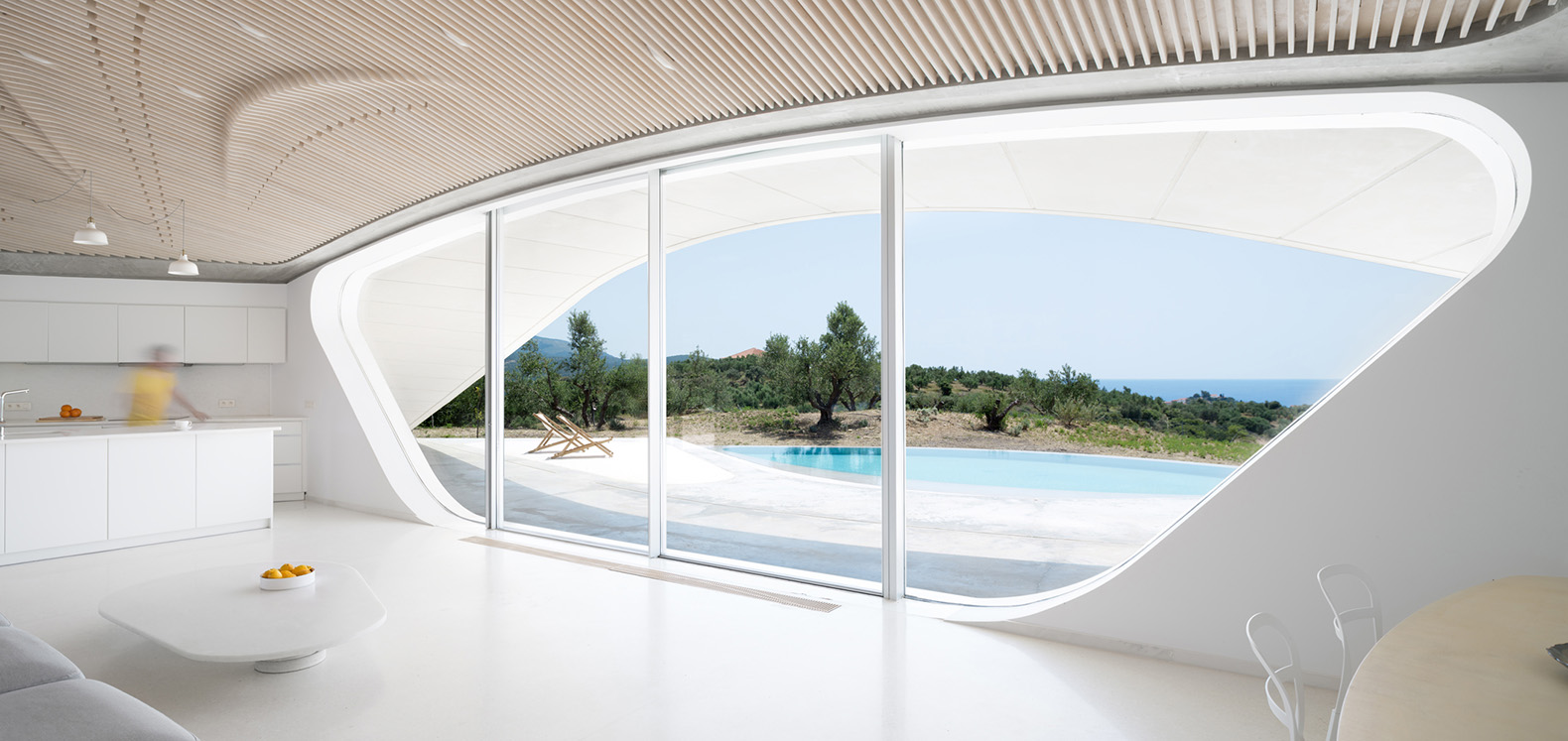 This amazing underground house in Greece frames views of an olive ...