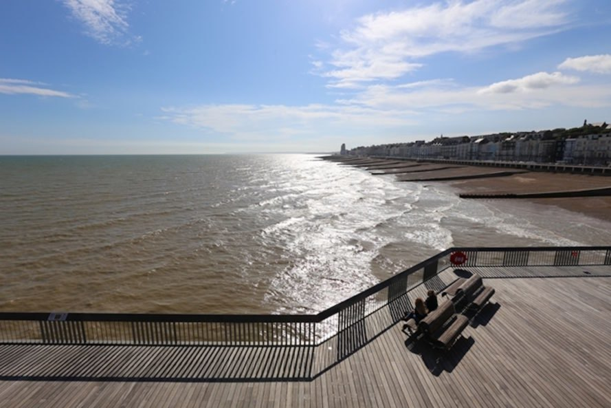 Hastings Pier by drMM architects, Hastings Pier RIBA Stirling Prize, Hastings Pier Heritage Lottery Fumd, Hastings Pier renovation, salvaged materials in pier construction, British seaside pier architecture, reclaimed materials from a fire, multipurpose public space by the sea