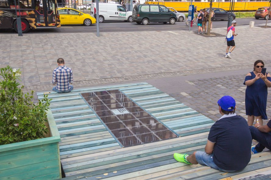 Platio, solar, solar power, solar energy, solar pavement, solar pavements, solar pavers, solar sidewalk, solar sidewalks, solar installation, design, city, green city, cities, green cities, sustainability, Budapest, Hungary, bench, smart bench, benches, wood, charge, charging, smartphone, smartphones, green technology
