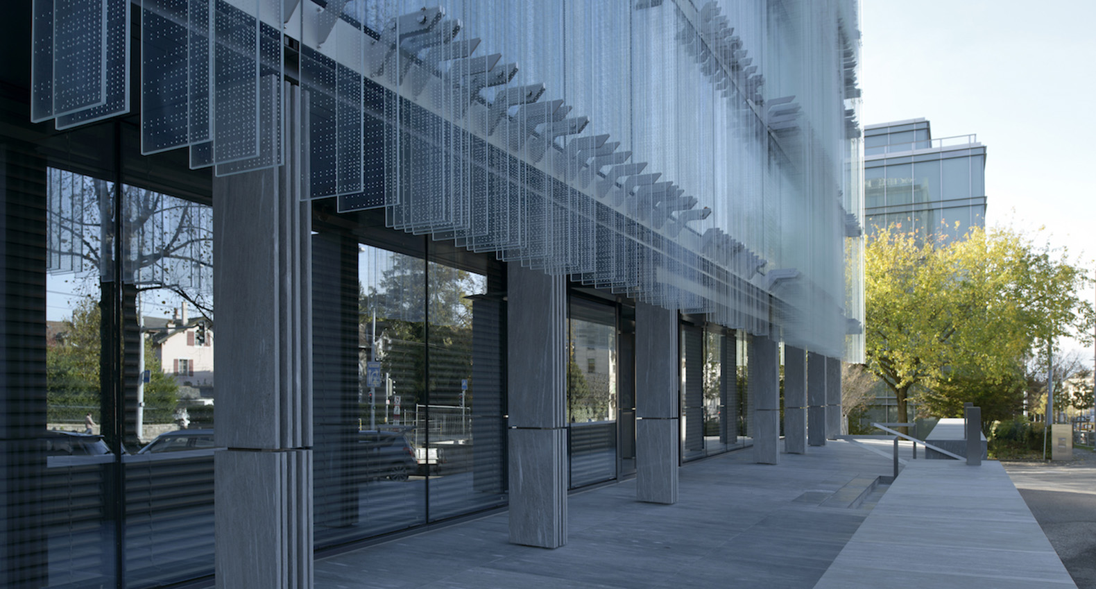 Naturally Ventilated Glass Building Looks Like A