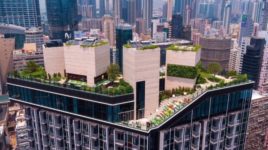 Skypark by New World Development, Skypark by concrete, New World Development and concrete, solar-powered apartments, Skypark by Hong Kong, Skypark by Mong Kok, rainwater recycling irrigation, Skypark by Adrian Cheng, Adrian L Norman rooftop garden, millennial co living spaces, millennial oriented design