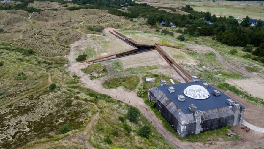 TIRPITZ by BIG, TIRPITZ by Tinker Imagineers, TIRPITZ by Varde Museums, TIRPITZ museum, TIRPITZ architecture, bunker museum, Blåvand museum, bunker adaptive reuse, war museum design, invisible museum