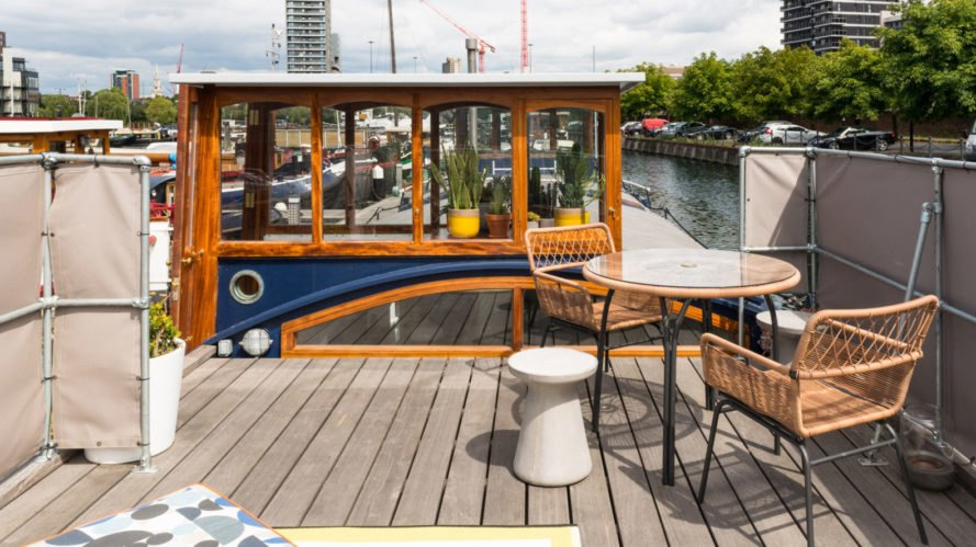 houseboat, London, floating home, green renovation, woodwork, floating architecture, wood burning stove, pendant lights, open plan layout, restoration
