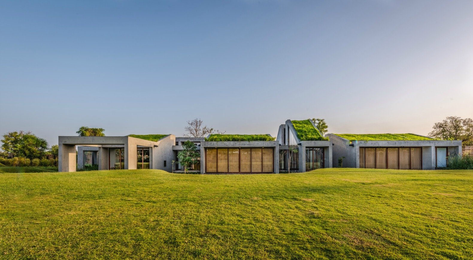 Stunning home in India blends into the earth with segmented green roofs