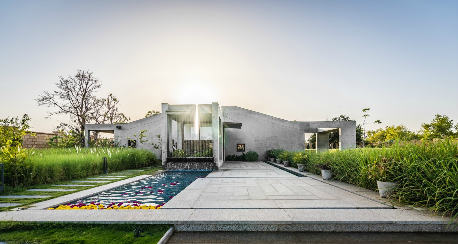 Stunning home in India blends into the earth with segmented green ...