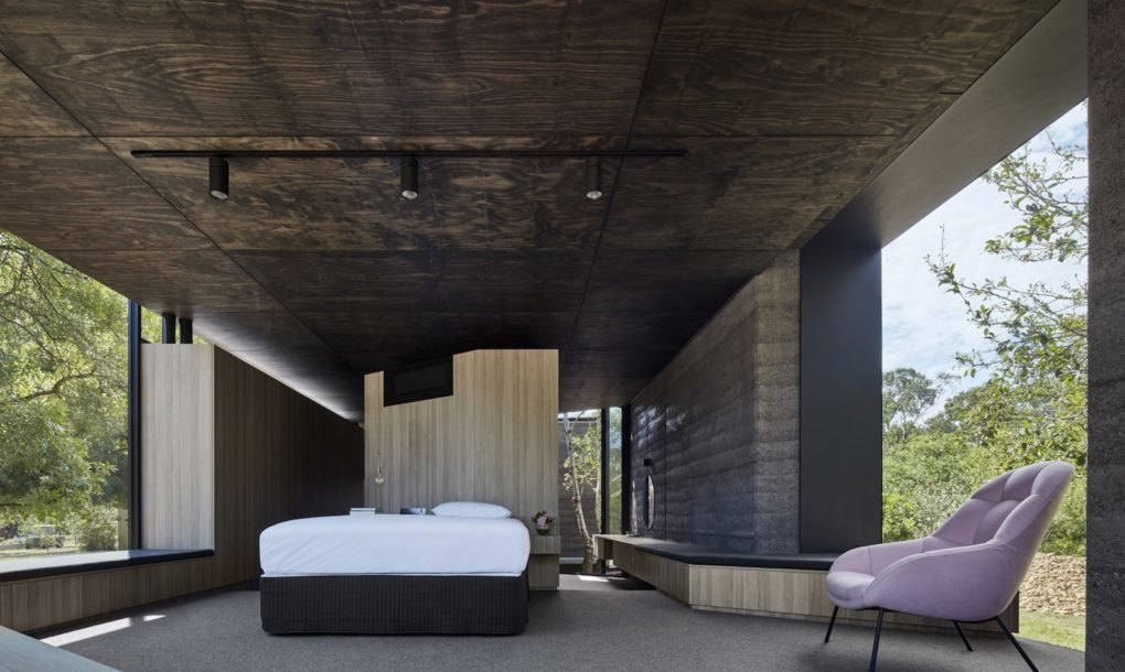 Rammed Charcoal Home Is A Handsome Oasis Between The Trees