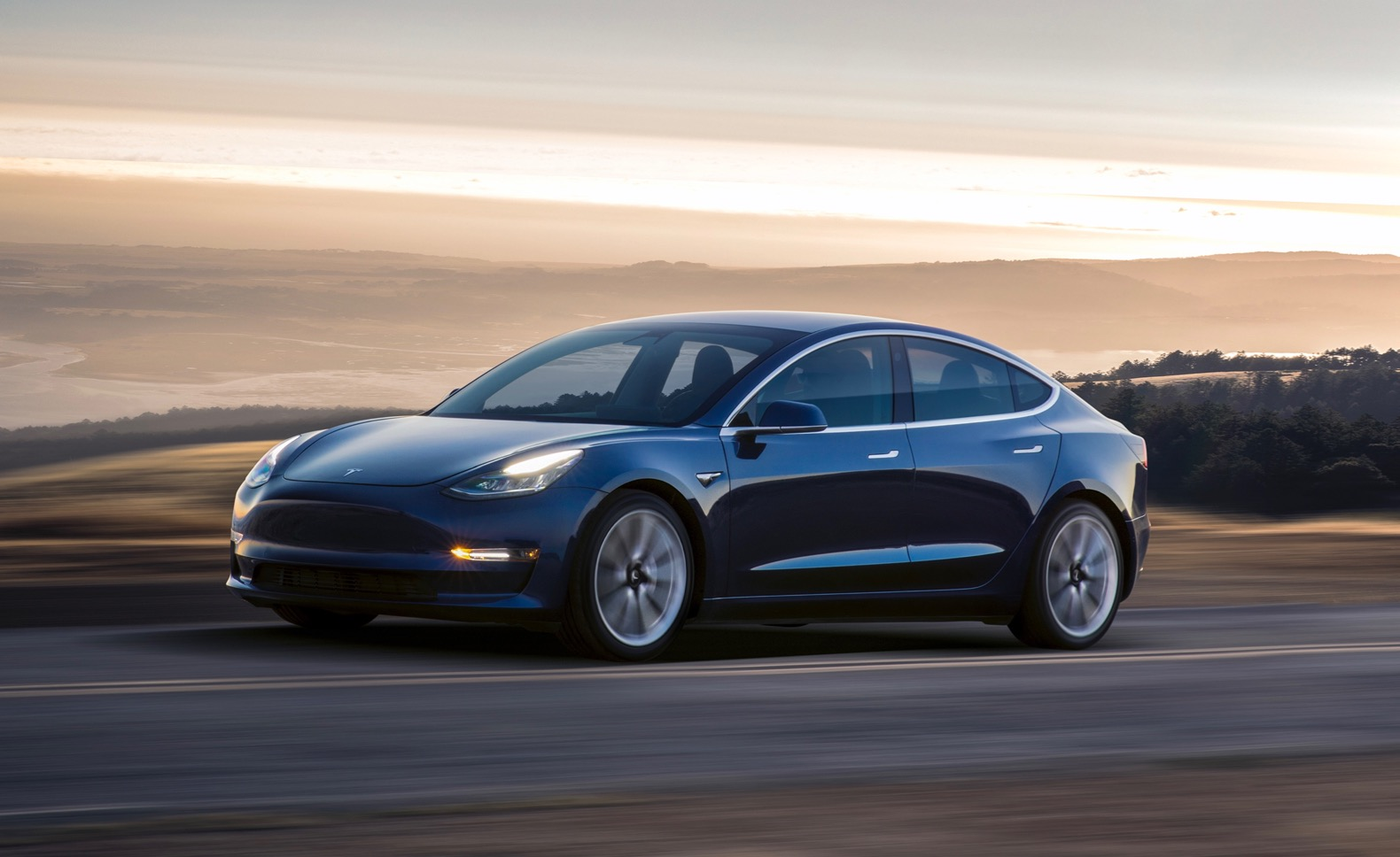 The tesla model 3 is now on the road here s everything we know
