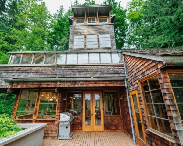 Jason McLennan, tree house tower, pugent sound tree house, seattle architecture, leo decaprio, reclaimed wood, reclaimed boat parts, home design, interior design, reclaimed furniture, green interior design, green architecture, porthole windows, Bainbridge Island, Bainbridge Island homes,