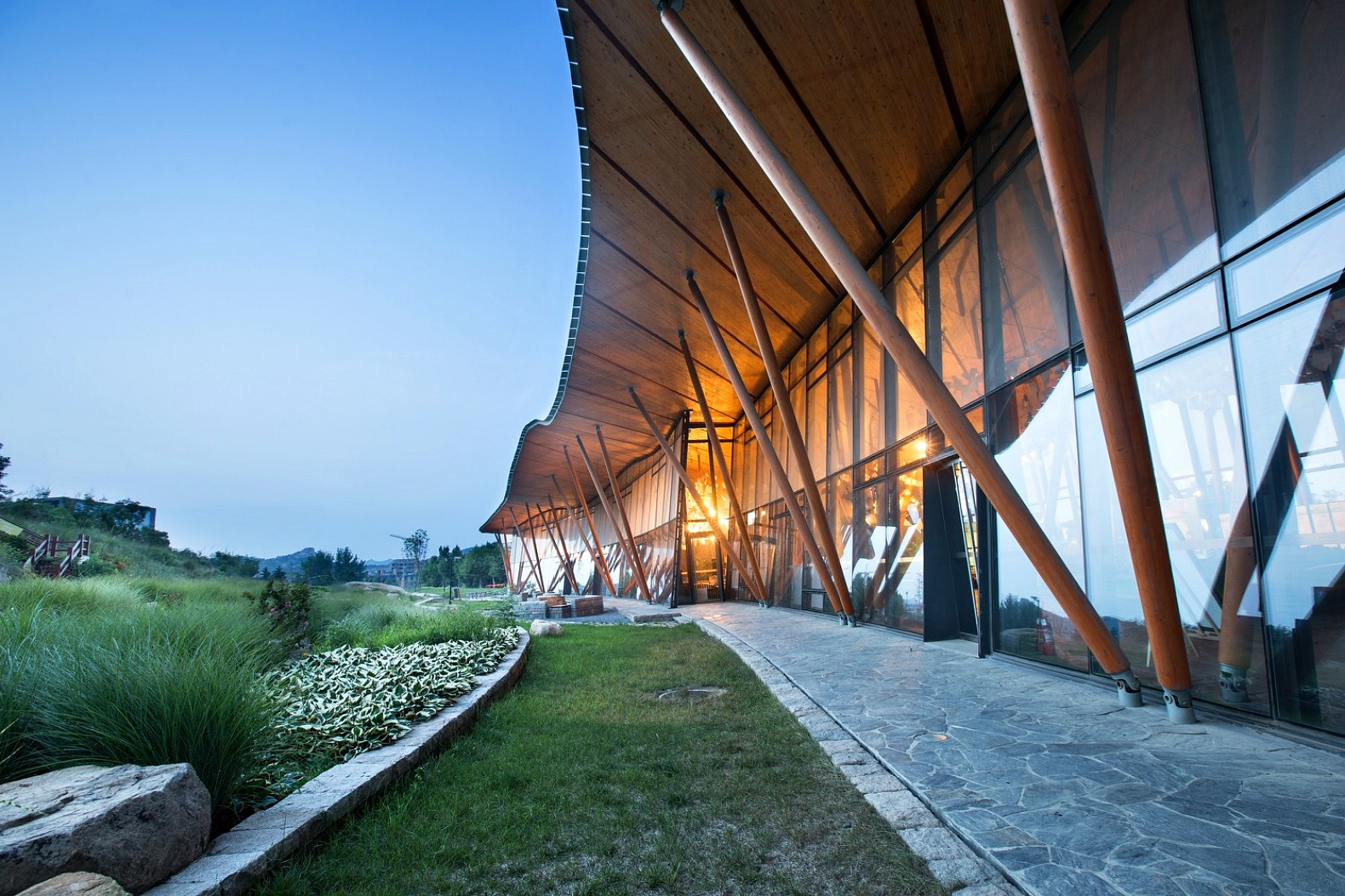 Vanke Tsing Tao Pearl Hill Visitor Center Blends Into The Landscape With A Rolling Green Roof
