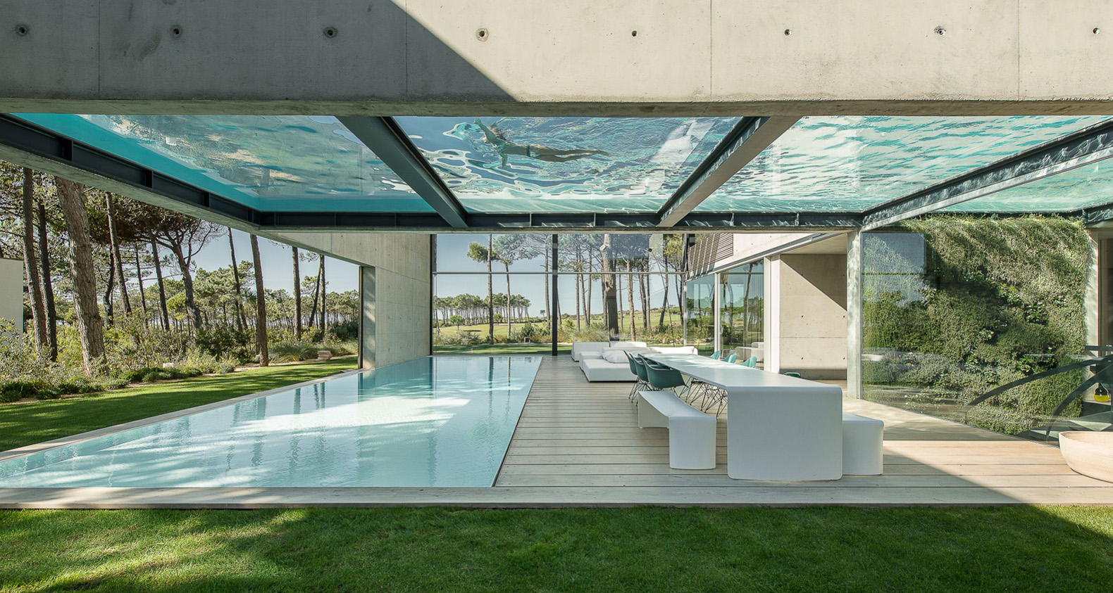Elevated glass-bottomed pool hovers over a second pool in ...