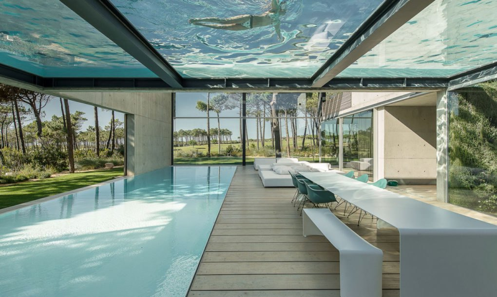 Elevated glass bottomed pool hovers over a second pool in the hip wall house inhabitat green - Glass bottom pool ...