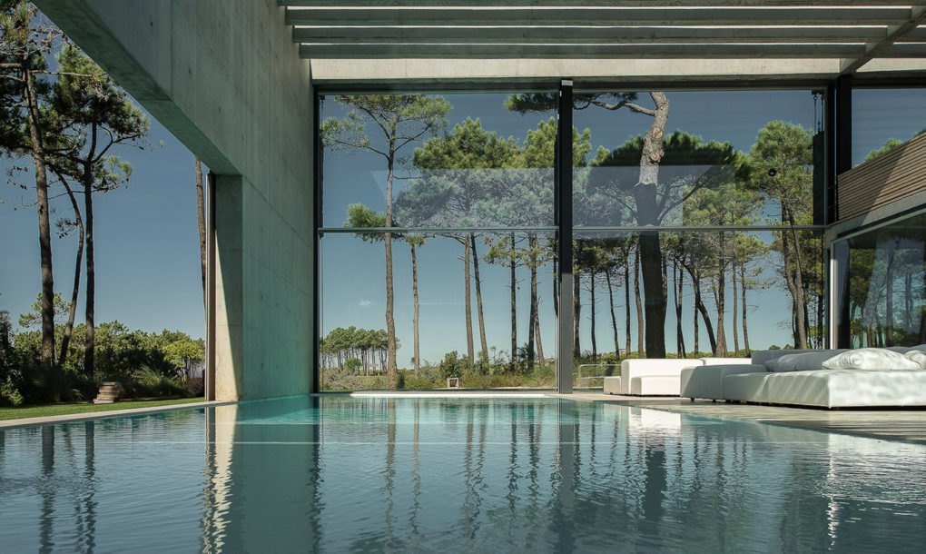 Elevated Glass Bottomed Pool Hovers Over A Second Pool In