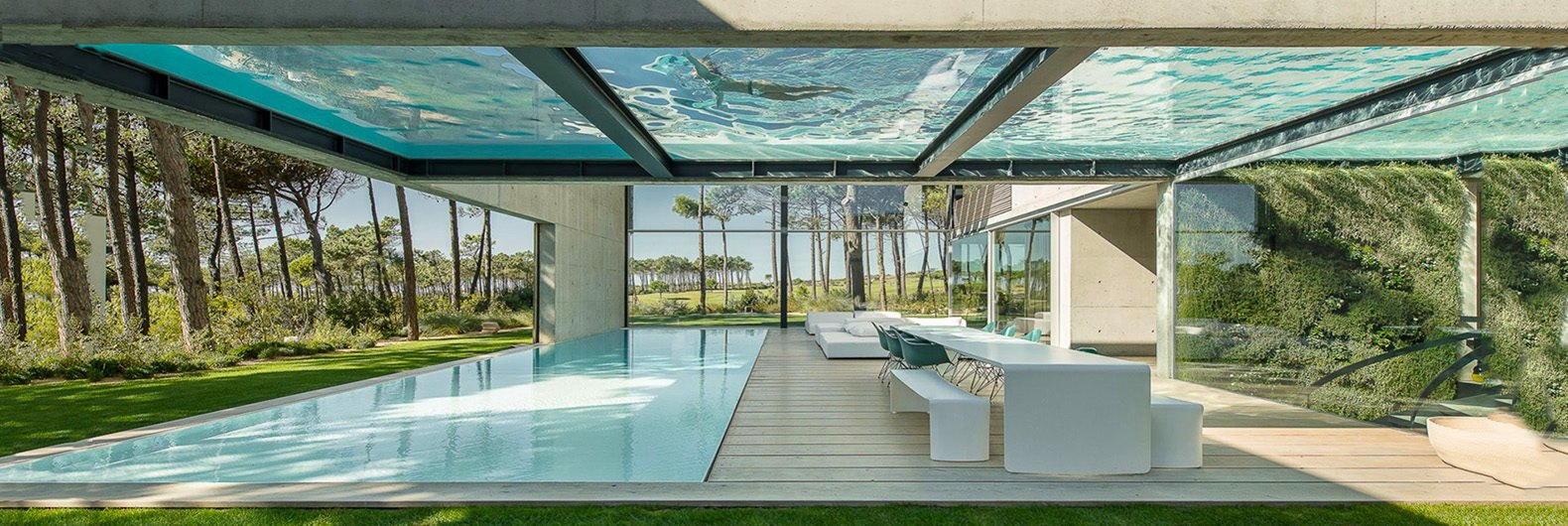 Elevated glass-bottomed pool hovers over a second pool in the hip ...