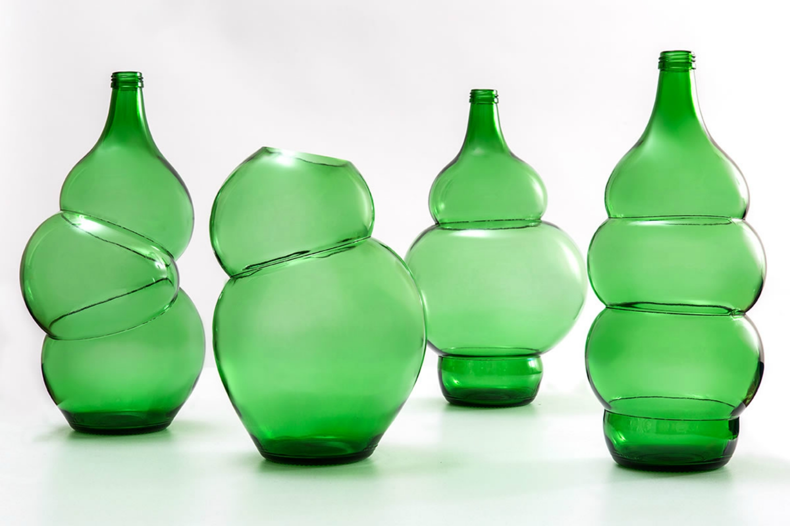 klaas kuiken turns common green bottles into incredible vases with this clever trick inhabitat. Black Bedroom Furniture Sets. Home Design Ideas