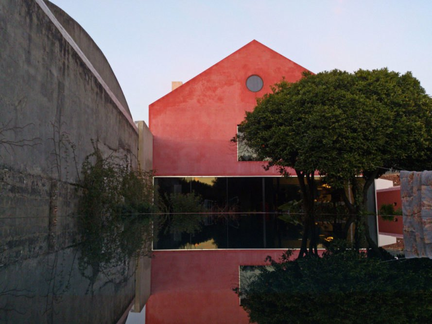 Red House by Extrastudio, Red House in Azeitao, winery transformed into home, adaptive reuse winery, Portugal adaptive reuse, contemporary architecture Portugal, minimalist and modern Portugal interior design, black glass sliding doors,