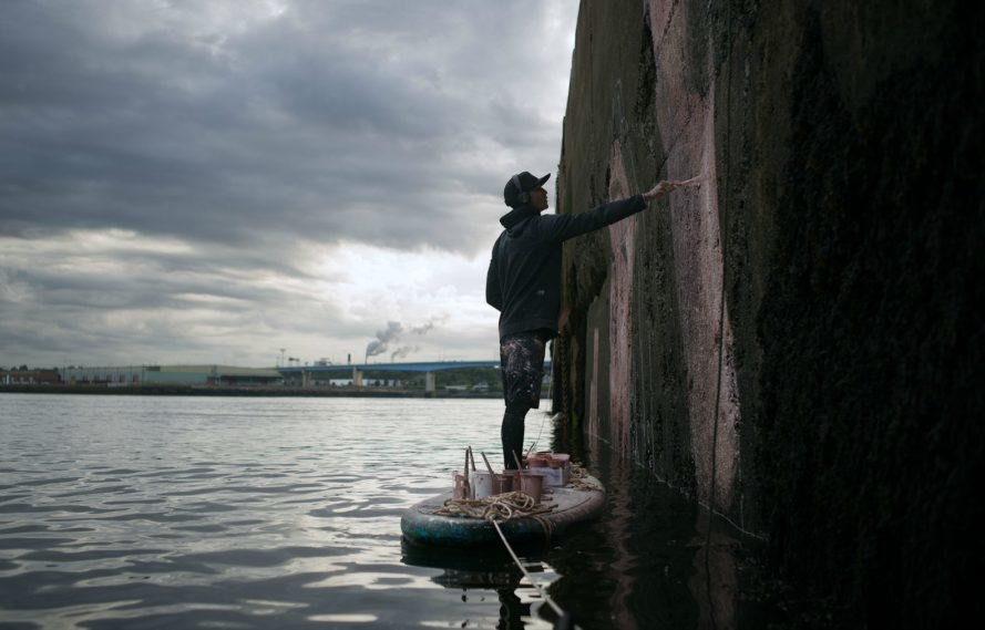 Sean Yoro, street mural, underwater art, underwater streetmural, surf artists, Bay of Fundy, tide art, Hula mural, nontoxic paint, Minas Basin mural, bay of fundy artwork, street art, public art, water art, surf art,