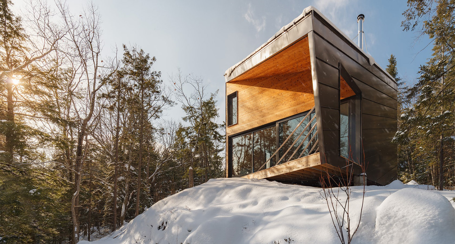 Prefab Tiny Cabin Perched On A Granite Rock To Minimize