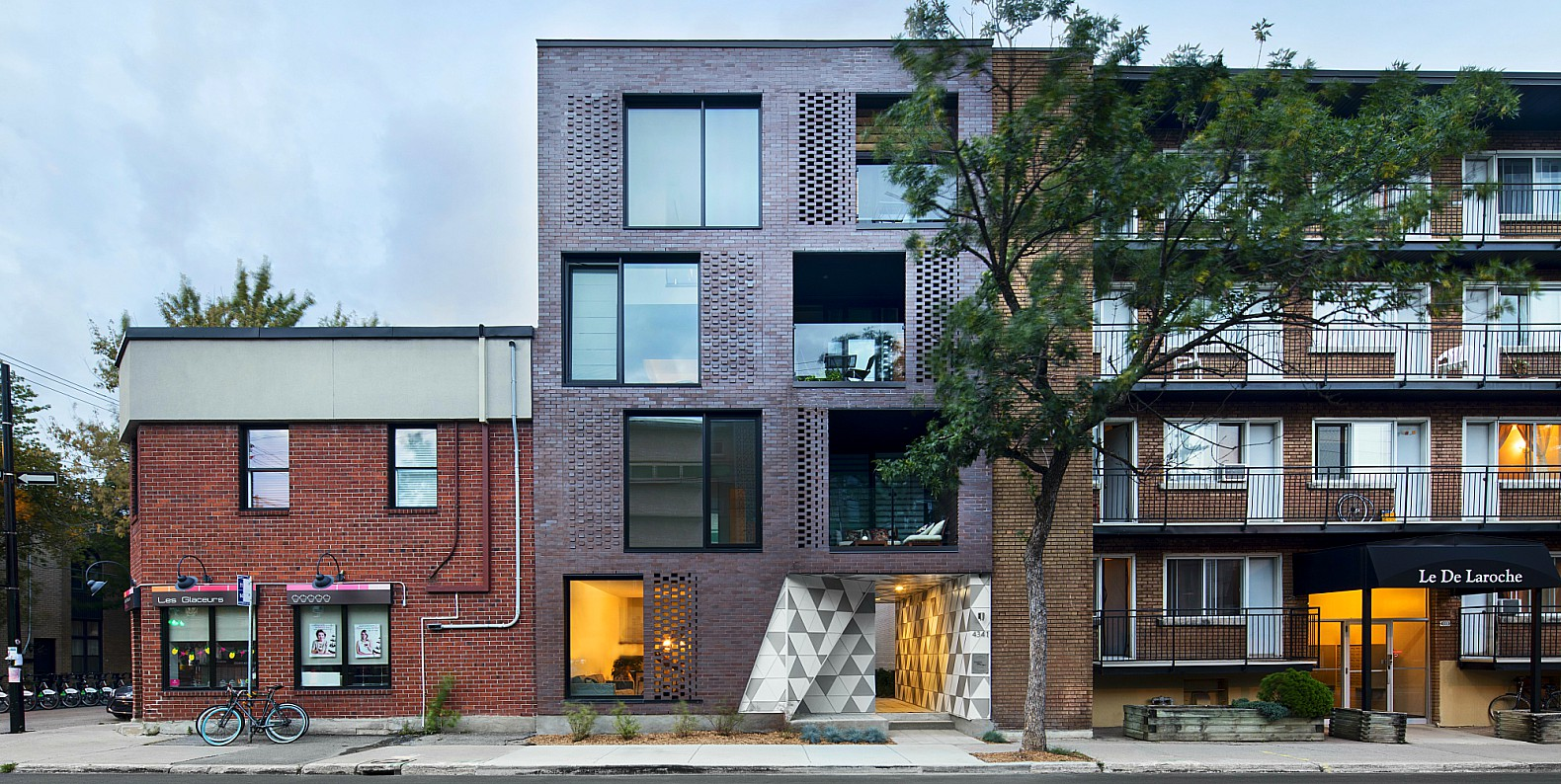 Leed seeking brick building in montreal hides funky geode like adhoc architectes la gode montreal architecture geode house montreal geometric geode home xflitez Image collections