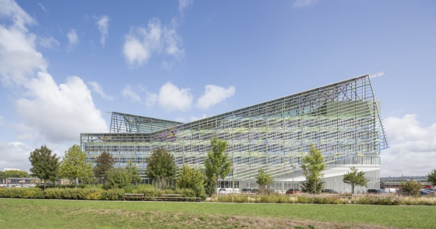 Métropole Rouen Normandie by Jacques Ferrier Architecture, Métropole Rouen Normandie, iridescent architecture, iridescent buildings, Monet-inspired architecture, double skin facade France, solar-powered Metropole building, colored glass with metal oxide