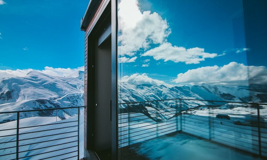 This gorgeous shipping container ski resort is tucked into for Ski designhotel