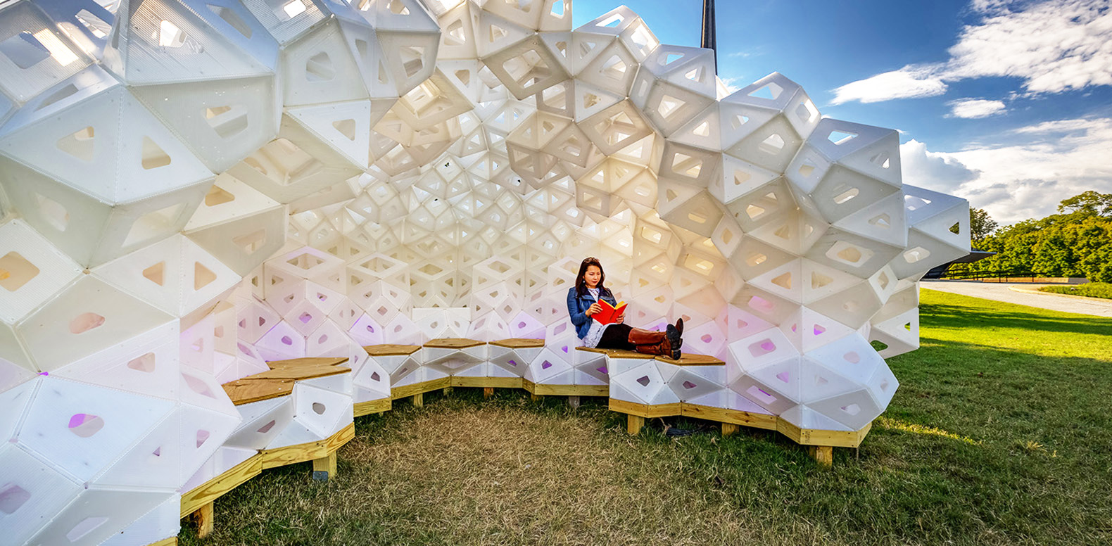 spectacular origami pavilion made of recycled plastic pops up in