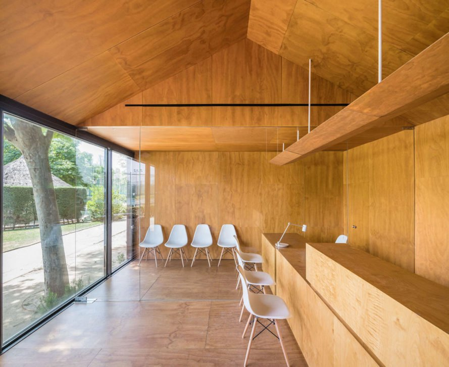 Tennis & Padel school office by BETA.o architecture office, BETA.ø architecture office, prefab office, prefabricated steel architecture, Madrid contemporary office architecture, pine plywood paneling, minimal site impact office design