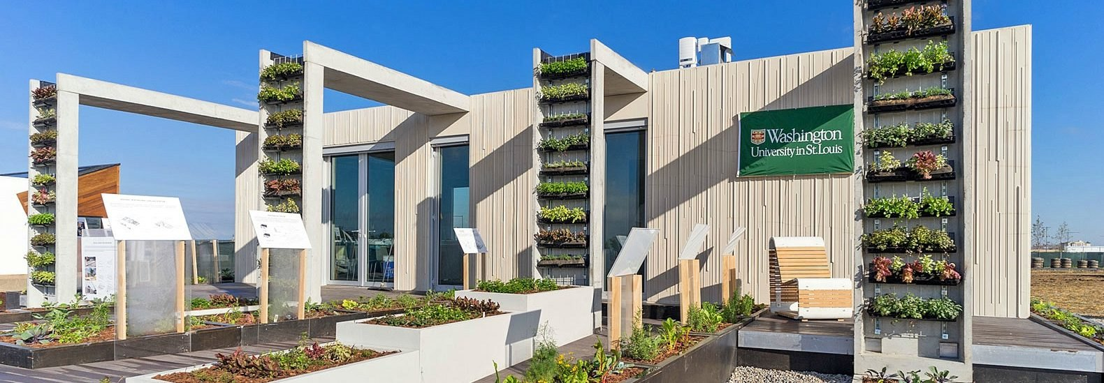 This prefab concrete house harvests rainwater with food-growing vertical gardens