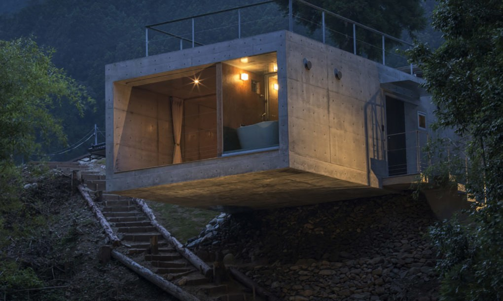 Striking Green Roofed House Cantilevers Over A Cliff In