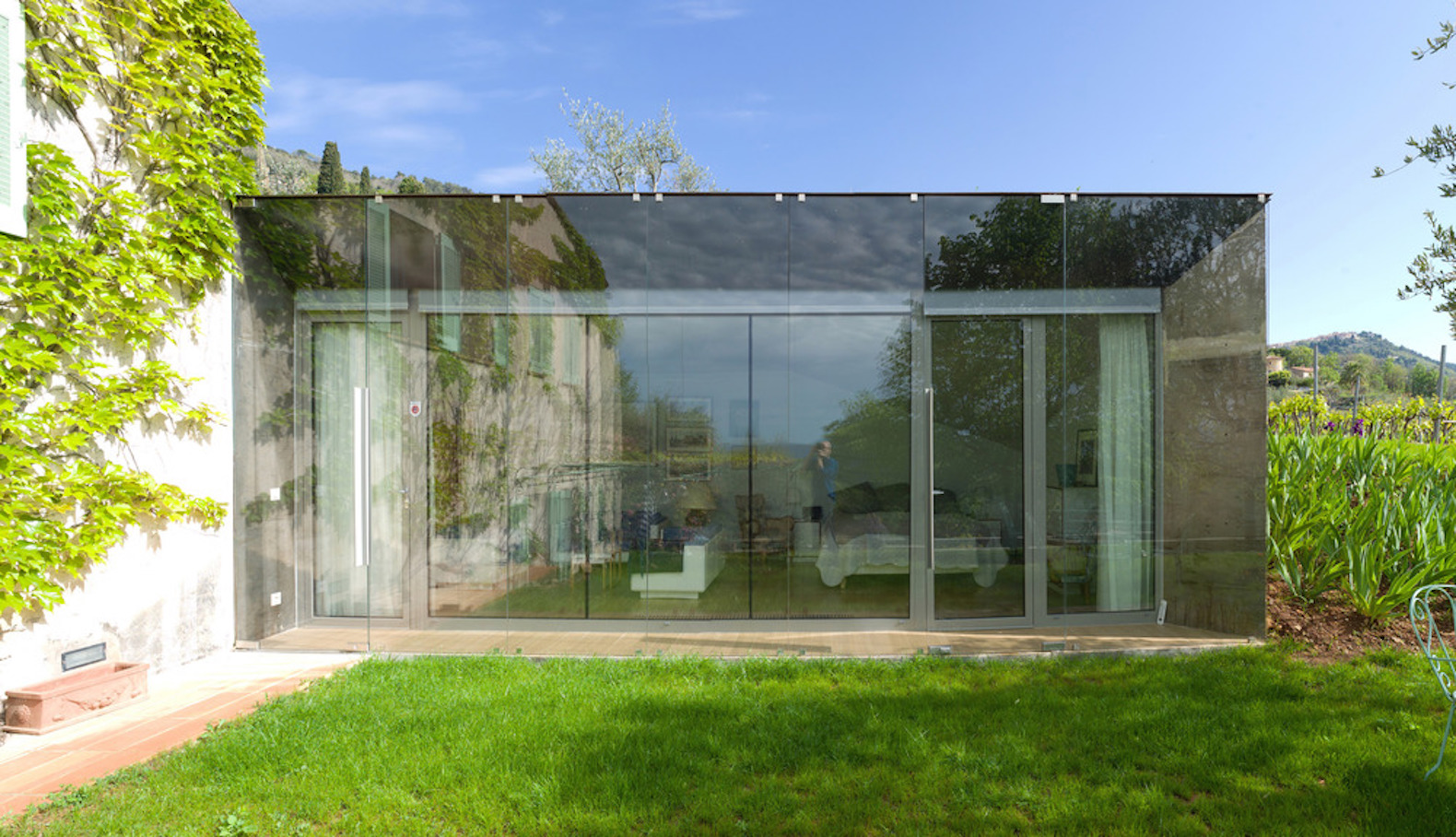 Light Filled Glass House Camouflages Itself Against A Hillside In France