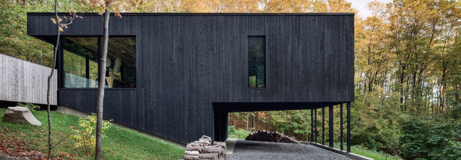 Modern Charred Timber House Juts Out Of Quebec S Forest