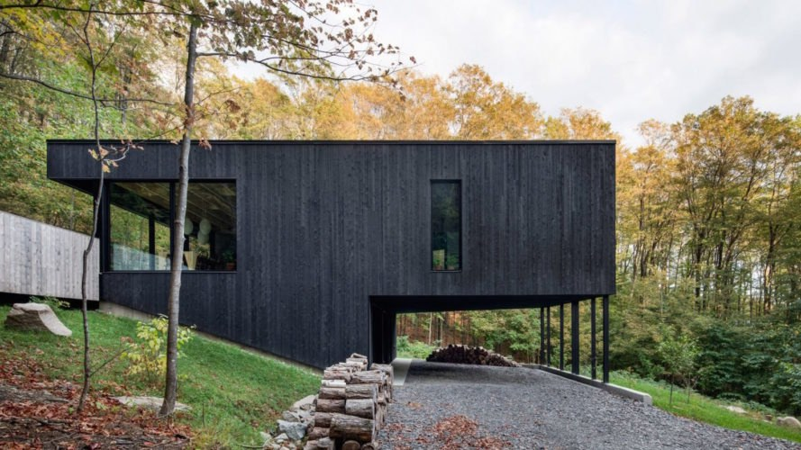 Modern Charred Timber House Juts Out Of Quebec S Forest Landscape