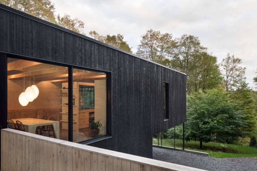 The Rock by Atelier General, The Rock house Quebec, Quebec forest cabin, black painted timber home, black painted timber architecture, Canada forest architecture,