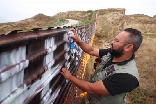 Artists are turning the U.S.-Mexico border fence into the world's longest peace-themed mural