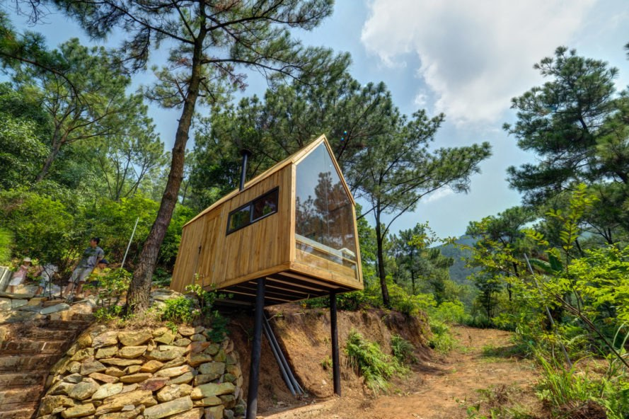 This low-cost forest house on stilts is a minimalist dream