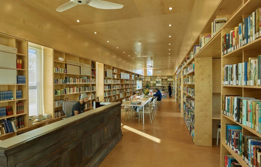 Newbern Library by Rural Studio, bank adaptive reuse, adaptive reuse library, bank turned into library architecture, Rural Studio Auburn University, Rural Studio social architecture, Newbern library, Old Bank building renovation, CNC milled birch plywood shelves