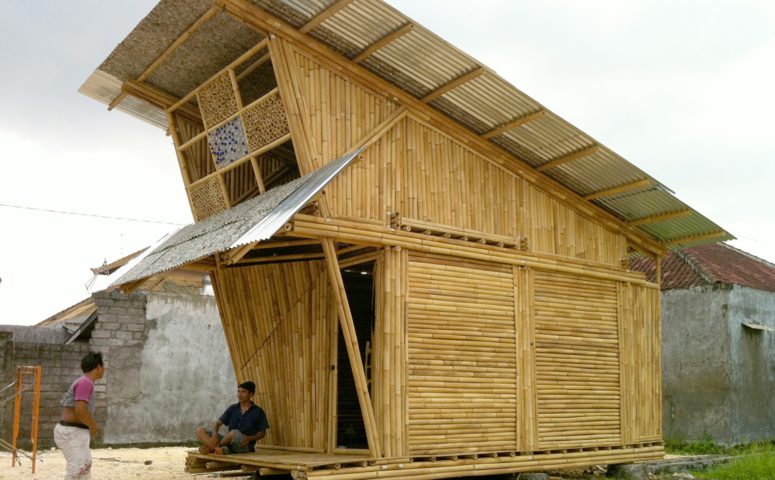 Ibuku unveils modular bamboo homes for garbage collectors for House made by waste material
