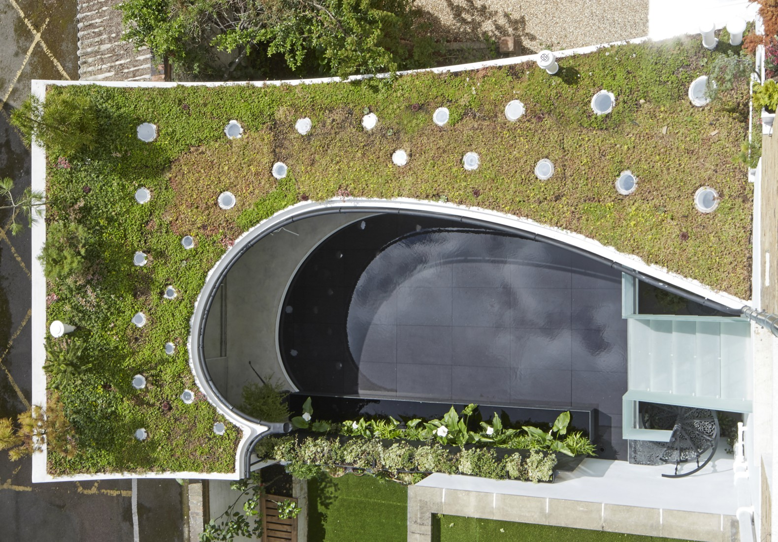 Gorgeous green-roofed studio features a rainwater reflecting pool