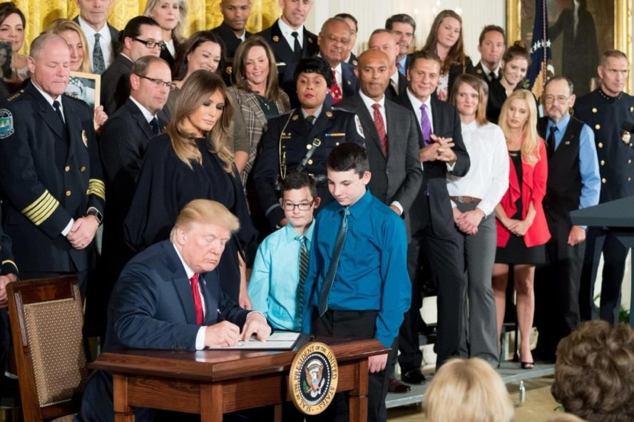 Trump signing, Trump signing law, Trump signing bill, Trump signing resolution