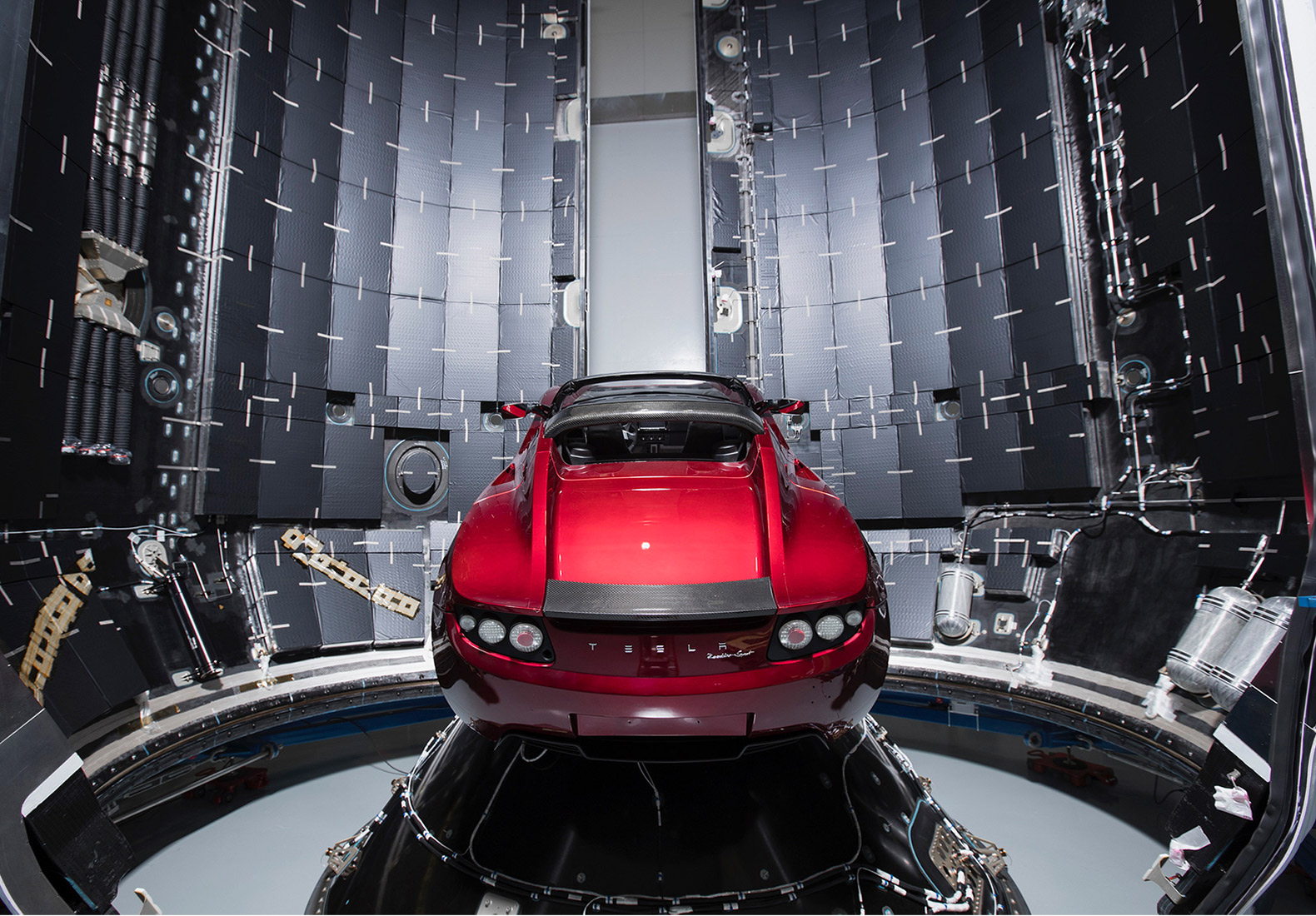 elon musk shares pictures of his red tesla roadster ready to blast off to mars