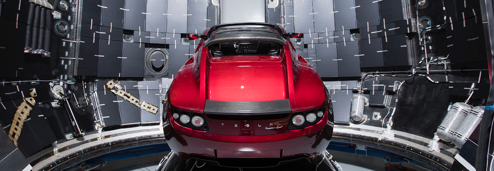 elon musk shares pictures of his red tesla roadster ready