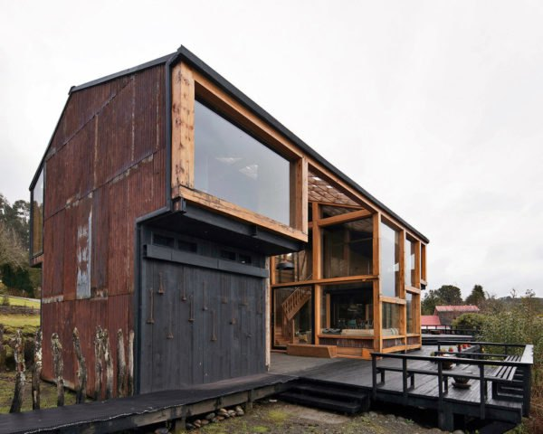 Casa Pollo, Ortuzar Gebauer Arquitectos, timber, reused wood, reused building mateirals, zinc, warehouse, green architecture, terrace, Chile, timber deck, vernacular architecture