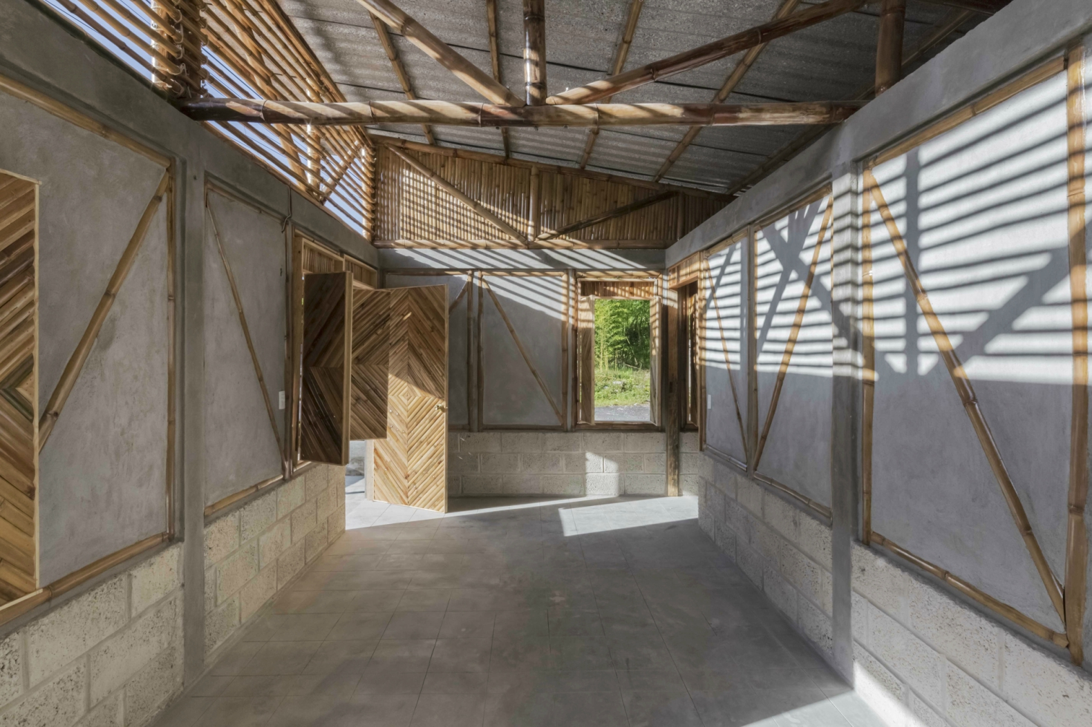 Local residents help build pre-fab bamboo social center that