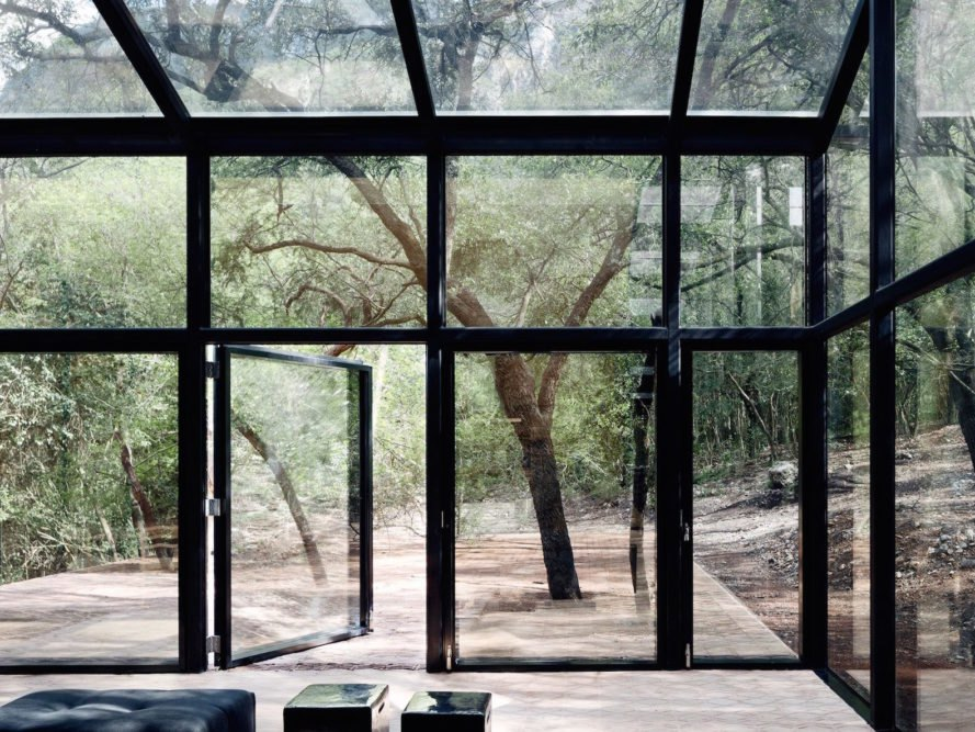 Los Terrenos by Tatiana Bilbao, mirrored glass architecture, mirrored glass home, reflective architecture, experimental glass home, rammed earth and clay brick house, mirrored glass greenhouse, chevron-shaped lattice, Monterrey contemporary architecture